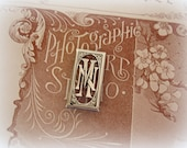 vintage double french monogram M N or N M silver plated rectangle with prongs