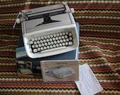 VINTAGE Royal brand SAFARI typewriter with original case and EXTRA ribbon