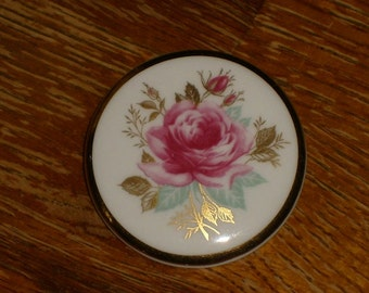 Vintage Royal Adderly bone china rose brooch with a gold rim