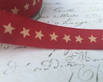 100% Cotton Red with cream stars 5/8 wide
