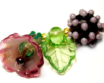 Handmade lampwork bell flower in purple pink with 1 leaf and one round