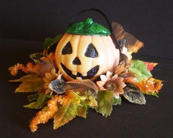 Retro Jack o lantern Halloween decoration floral arrangement vintage old fashioned spooky pumpkin flowers centerpiece