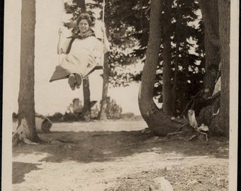 Vintage photo 1914 Tillamook Oregon Young Woman Swings High in Trees Vintage Snapshot photo