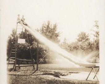 vintage photo Ethereal Light Glowing off Large Children's Slide at Park