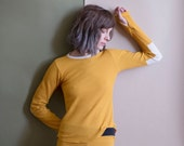 size XSMALL. Marigold thermal pajama set. Long sleeve and thumbhole top, and matching thermal leggings. Last available and ready to ship.