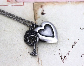 palm tree. heart locket necklace. in silver ox jewelry