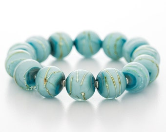 blue bracelet, glass, silver, stretch style, artisan lampwork jewelry