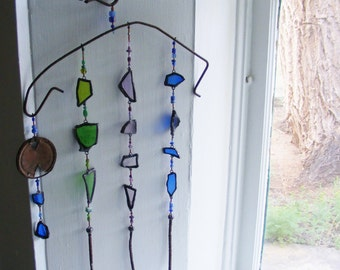 BIRDMAN suncather, Recycled, Upcycled, window art, Home Decor, goth wicca fae, Stained Glass, rust arroyo glass
