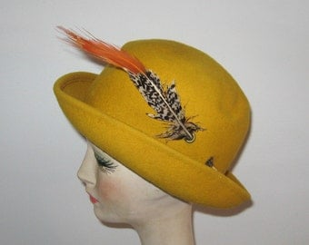 yellow felt hat . yellow felt hat with feather . exotic bird feather