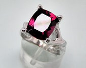 Reserve listing for Diane G. AAAA Rhodolite Raspberry garnet 4.04 Cts 10X8mm. in a 14k Rose gold ring Final Pymt