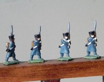 Vintage four lead toy soldiers - metal painted blue green black