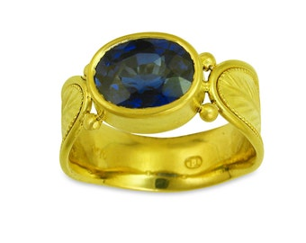 18k gold Palmate Leaf Ring with Blue Sapphire made with 100 percent recycled gold