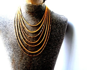 Industrial vintage 80s gold tone metal , seven chain bib necklace.
