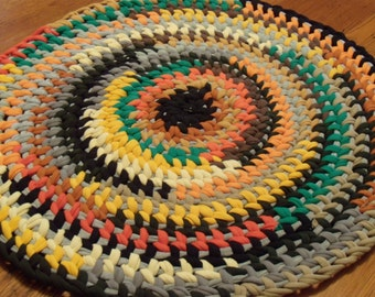 """One Of A Kind. T Shirt. Rugs. Fall Colors. All Cottons. Tooth Brush Braided. Round. Washable. 25"""" Across."""