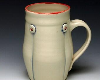 Handmade ceramic coffee mug, White with red, and blue highlights, 12oz