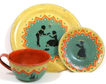 1930s SILHOUETTE tin toy tea setting by Ohio Art Co. Girl, boy & cat.
