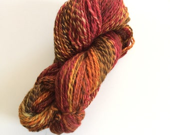Handspun 2 ply multi color wool yarn approximately 212 yards. Oranges,yellow,greens,red