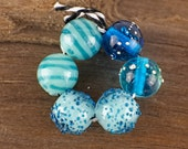 lampwork set of 6 round beads......... sra