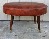 1950's Retro Brown Vinyl Oval Top Ottoman with Tapered Wooden Legs