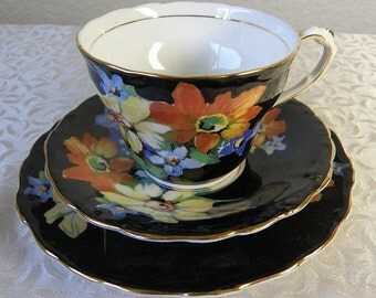 Bright FLOWERS on BLACK.. Cup and Saucer and Plate..PARAGON