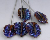 5 handmade leaf-tipped glass headpins w/sterling silver wires in a dark iridescent amber/purple glass - Iridescent Leaf Headpins