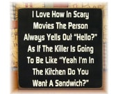 I love how in scary movies the person always yells out hello... funny wood sign
