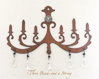 Rusty Metal Chandelier with Crystals and Vintage Brooch Wall Decoration