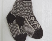 Handknitted norwegian socks in brown and off white for children