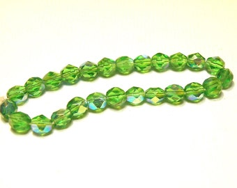40% OFF -- DESTASH - 25 Green Glass Faceted Oval Beads with Iridescent Coating -- Lot 3A