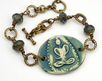 Blue Buddha bracelet, antiqued brass, boho zen, faceted glass beads, 7 3/4 inches long, Laurel Moon Jewelry