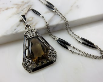 Circa 1920 Sterling Silver and Enamel Pendant set with Smoky Quartz