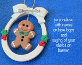 Gingerbread boy ornament personalized oval with red and green holly bowtie with red crystal
