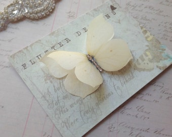 Cream silk Brimstone butterfly hair clip with Crystal detail. Perfect for weddings!