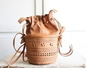 tooled leather crossbody bucket bag Moroccan vintage