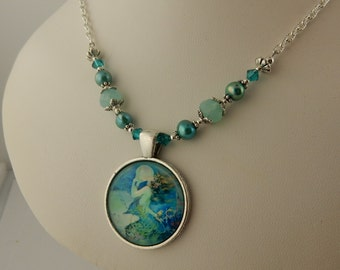 Mermaid glass Cabochon pendant beaded with teal freshwater pearls and Swarovski crystals