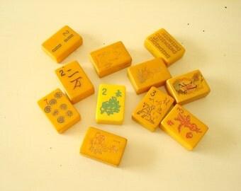 11 vintage Bakelite mah jongg tiles, mahjong game tiles, carved images of crak, dot, bam, flower, mah jong, mahjongg
