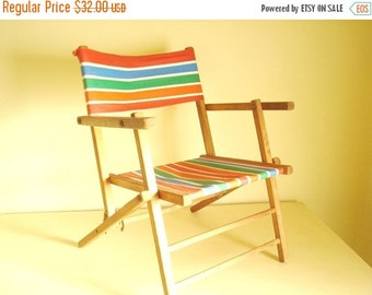 Childs striped canvas folding chair, kid vintage beach chair, fold seat, collapsible wood frame, camping gear, red blue orange green stripes