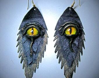 Dragon eye black antiqued genuine leather earrings.  Leather Feather earrings. Halloween earrings. Handmade leather earrings.