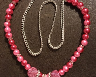 Necklace, 24 inch, pink two-toned pearls, pink crystal rhondelles, and silver flamingo charm