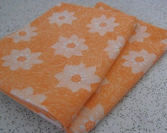 floral in orange...pair of vintage pillowcases