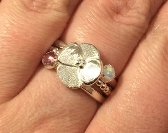 Handmade flower stacking ring with pink tourmaline and lab opal set in sterling silver