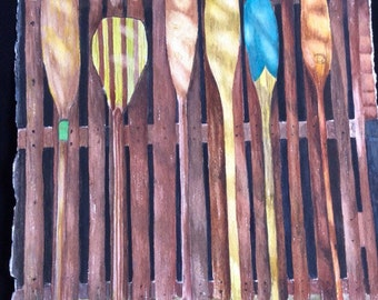 Watercolor print of vintage canoe paddles standing up on a fence