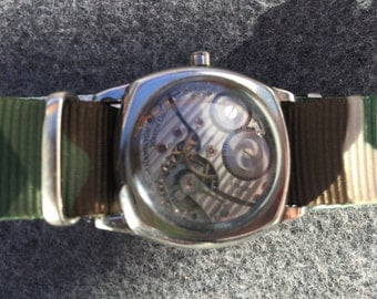 Art Deco Watch Face with Gears Featured inside the Face.