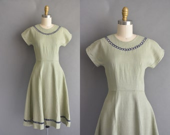 vintage 1950s dress / 50s soft green linen cut out neckline vintage dress