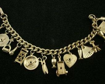 Vintage Gold Tone 15 Charm Curb Link Bracelet, Love Me Spinner, Ladder, Roulette Spinner, Scissors, Lie Detector Spinner, etc