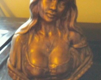 Busty maiden sculpture