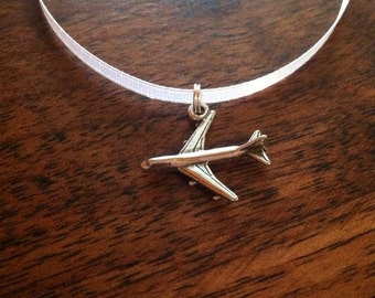 Sterling silver airplane cake pull charm on white satin ribbon by kellylynndesigns on etsy.com