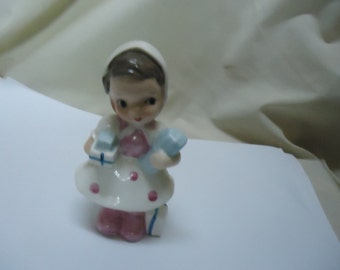 Vintage Ucagco Woman In Dress Carrying Gifts or Boxes Figurine, collectable