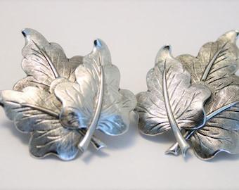 Vintage leaf earrings.  Clip on earrings.  Silverplated leaf earrings