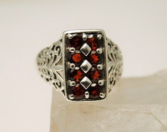 Garnet and sterling silver ring.  UK size N. US size 6 3/4